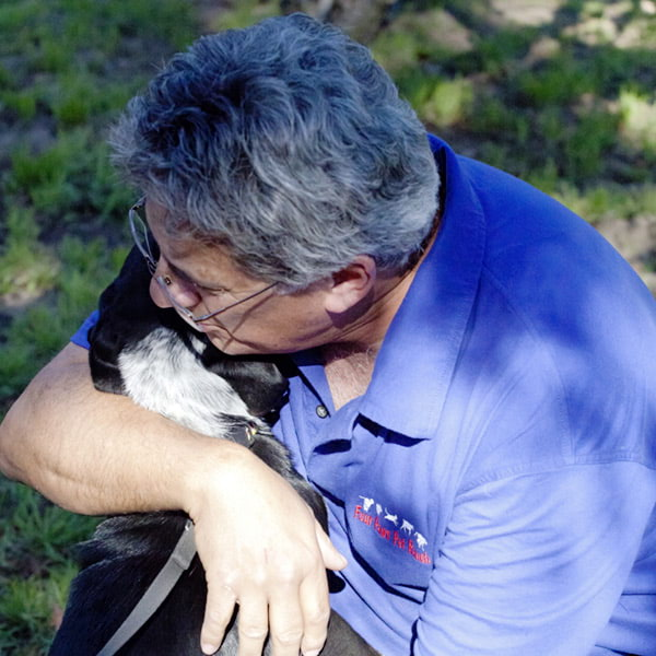 Four Paws Pet Ranch Owner and Dog